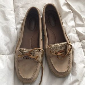 Tan and gold sperry topsiders